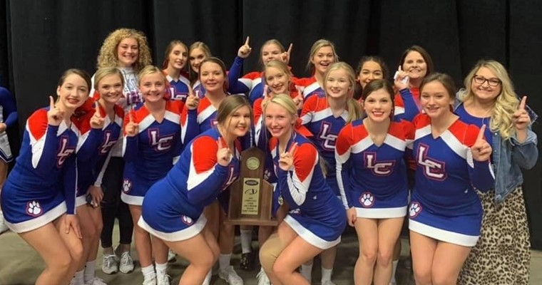 LCHS Varsity Cheerleaders winning the Region Championship